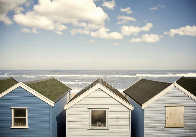 Row of blue beach huts — Stock Photo