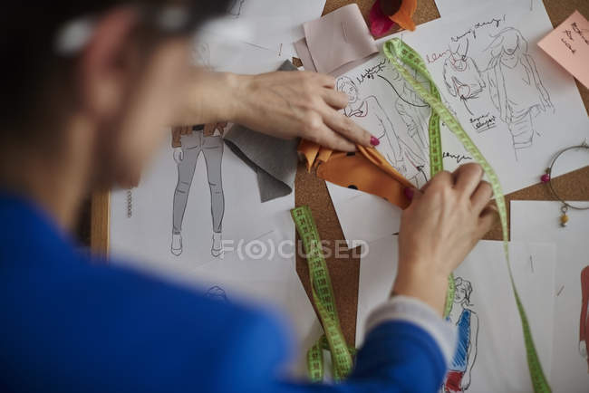 Over shoulder view of woman looking at mood board — Stock Photo