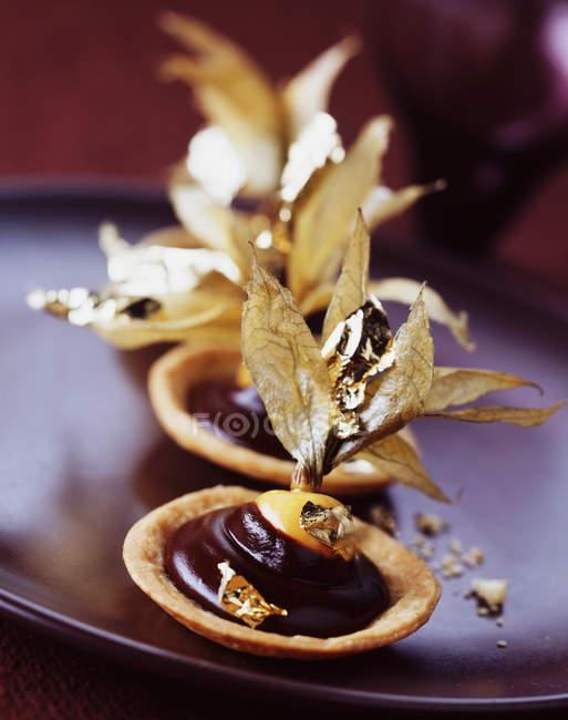 Close up of cape gooseberry chocolate tarts — Stock Photo