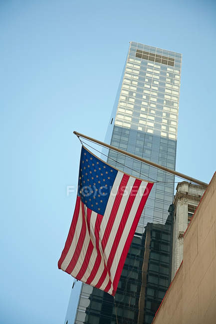 American flag hanging from building — Stock Photo