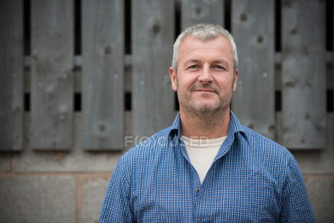 Portrait of farmer smiling, head and shoulders — Stock Photo