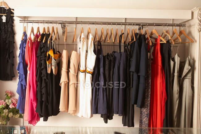 Rack of dresses and skirts — Stock Photo