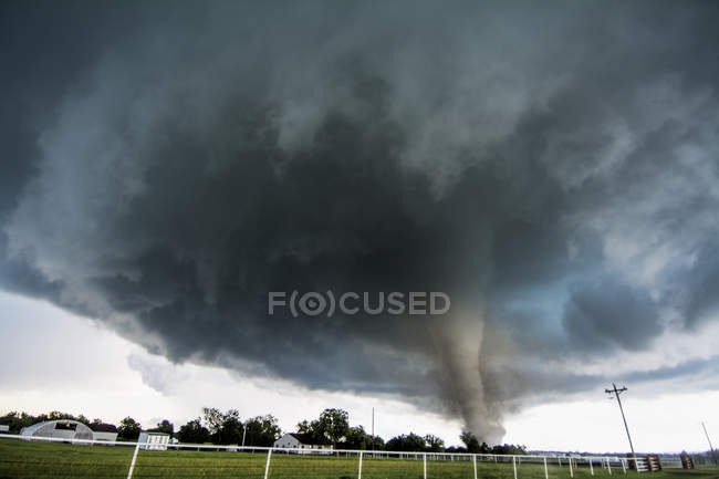Storm cloud and tornado in countryside — Stock Photo
