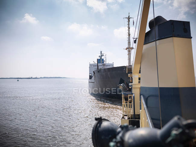 View from deck of tugboat of ship — Stock Photo