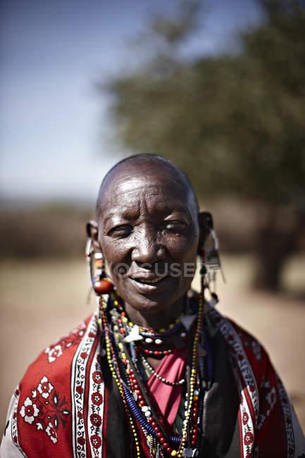 Smiling Maasai woman wearing jewelry — Stock Photo