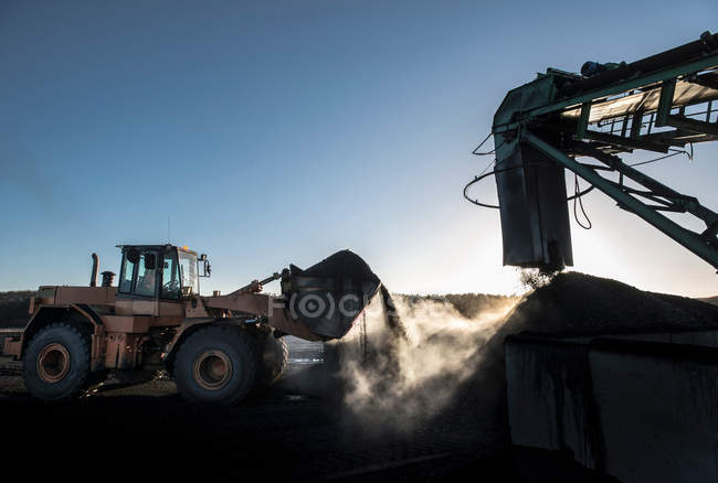 Steam rising from coal in morning light at surface coal mine — Stock Photo