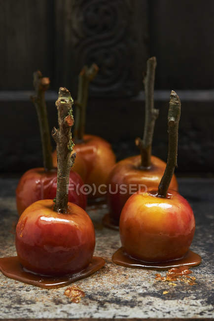 Toffee apples on sticks — Stock Photo