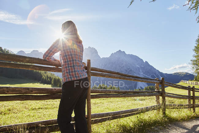 Female hiker looking out at Dolomites, Sexten, South Tyrol, Italy — Stock Photo