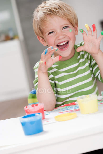 Young boy playing with colours — Stock Photo