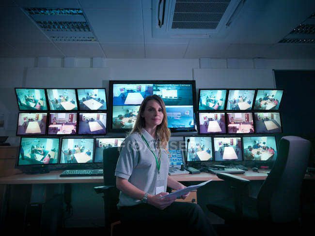 Portrait of student with screens in forensics training facility — Stock Photo