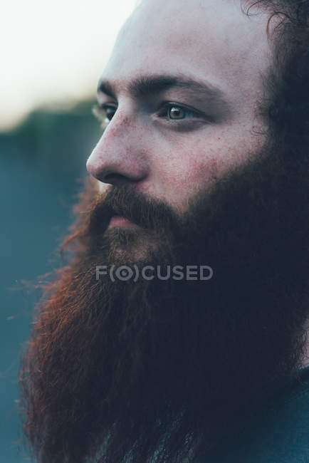 Close up portrait of gazing, bearded young male hipster — Stock Photo