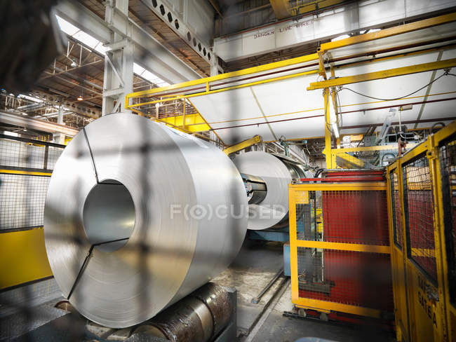 Front view of steel rolls in car factory — Stock Photo