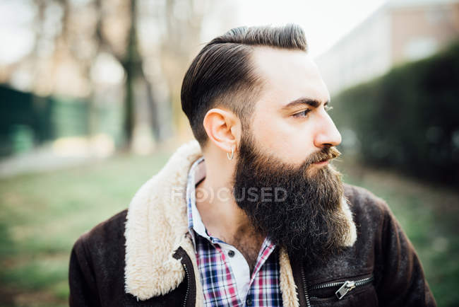 Young bearded man in park — Stock Photo