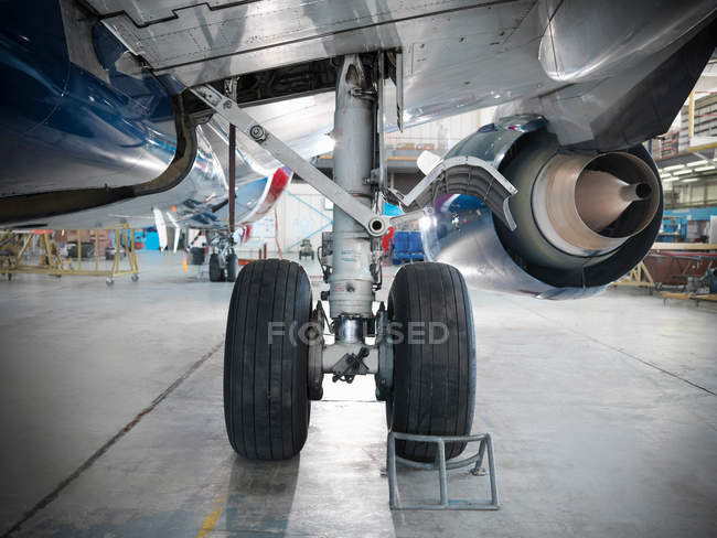 Undercarriage of airplane in hangar — Stock Photo