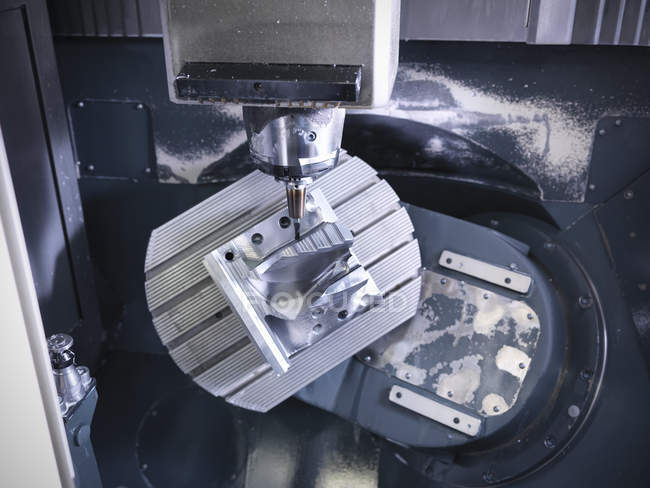 Complex steel part on computer numerical controlled, CNC, lathe in factory — Stock Photo