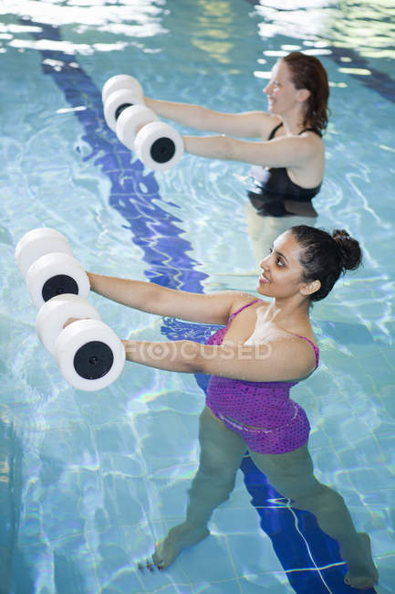 Women exercising in indoor pool — Stock Photo