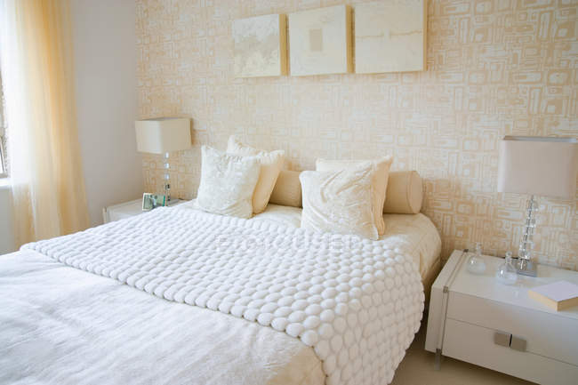 White bed with pillows — Stock Photo