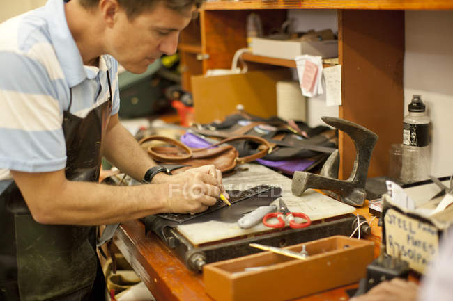 Cropped image of Cobbler working at workshop — Stock Photo