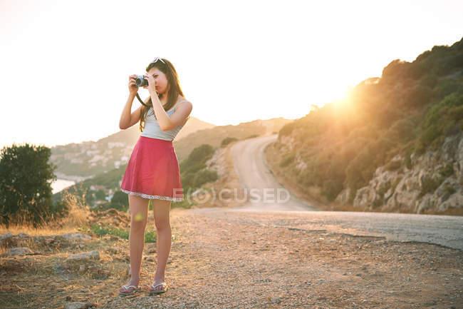 Girl taking photographs at sunset, Kas, Turkey — Stock Photo