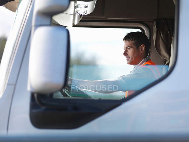 Truck driver in truck cab — Stock Photo