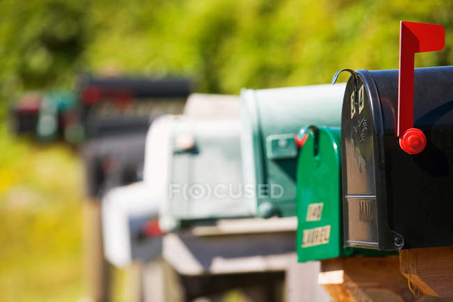 Mailboxes standing in row, differential focus — Stock Photo