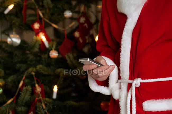 Santa Claus using cellphone, cropped shot — Stock Photo