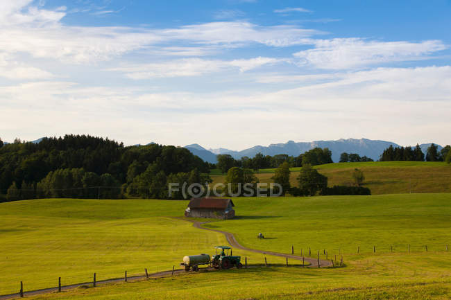 Tractor driving on dirt road — Stock Photo