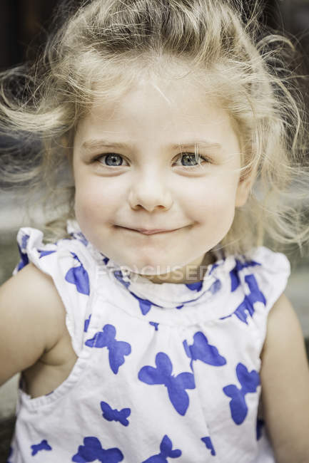 Close up portrait of female toddler in butterfly dress — Stock Photo