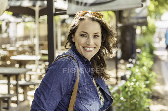 Portrait of mid adult woman at sidewalk cafe, Franschhoek, South Africa — Stock Photo