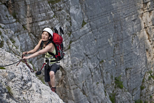 Female climber on via ferrata Che Guevara, Monte Casale, Trentino, Italy — стокове фото