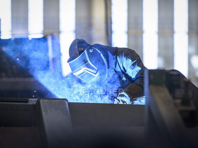 Worker protective mask welding in factory wearing — Stock Photo