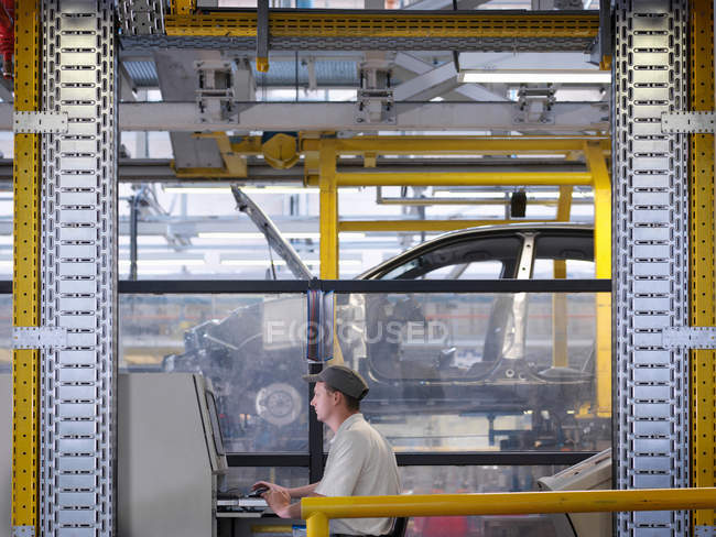 Worker At Controls On Production Line — Stock Photo