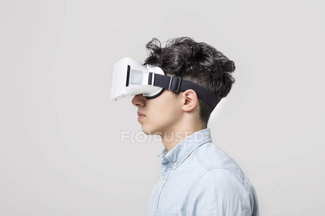 Young man wearing virtual reality headset — Stock Photo