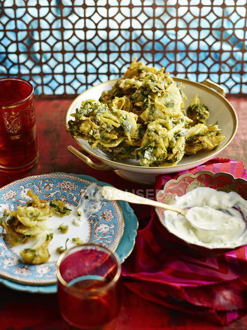 Onion bhajis and mint chutney served on table — Stock Photo