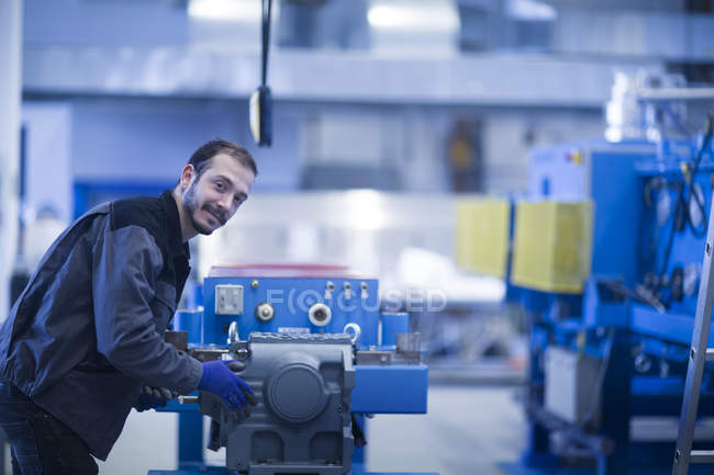 Young adult male Engineer operating heavy machinery — Stock Photo