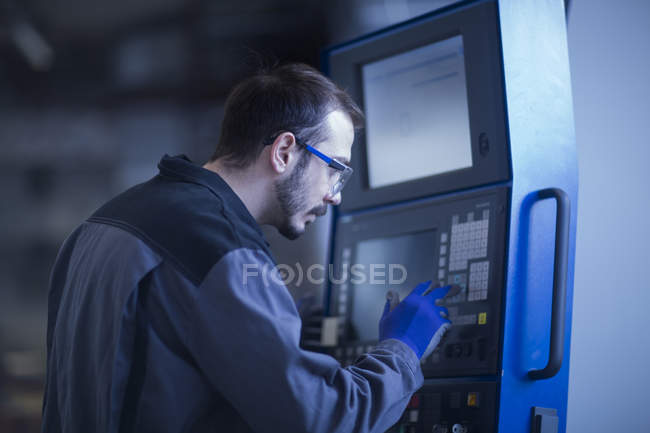Young adult male Engineer operating control panel — Foto stock