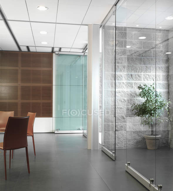 Modern office interior with glass doors — Stock Photo