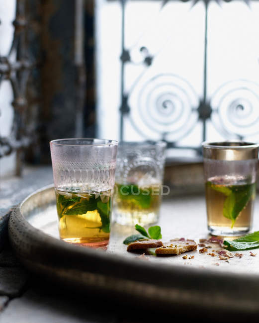 Glasses of mint tea with biscuits — Stock Photo