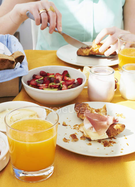Cropped image of Woman having breakfast — Stock Photo