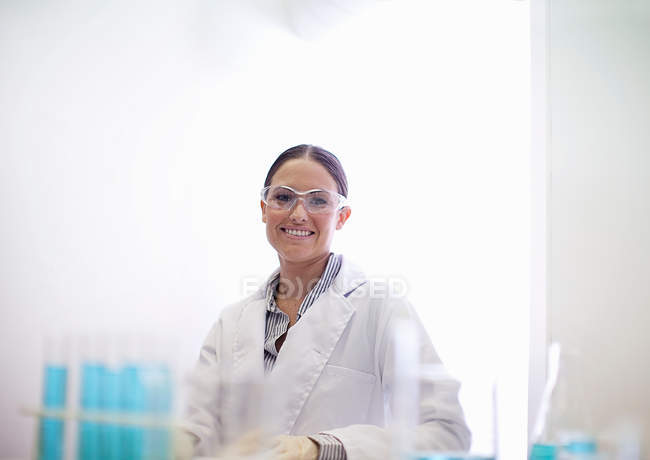Scientist smiling in lab — Stock Photo