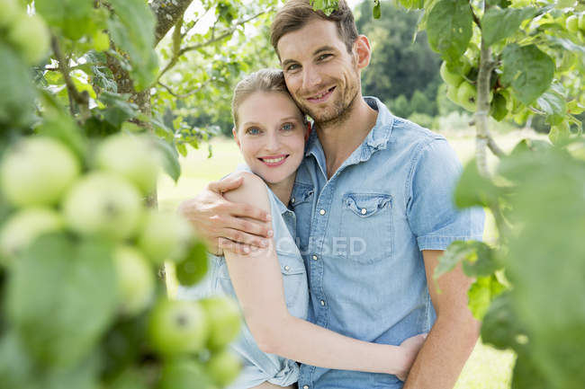 Mid adult couple with arms around each other — Stock Photo