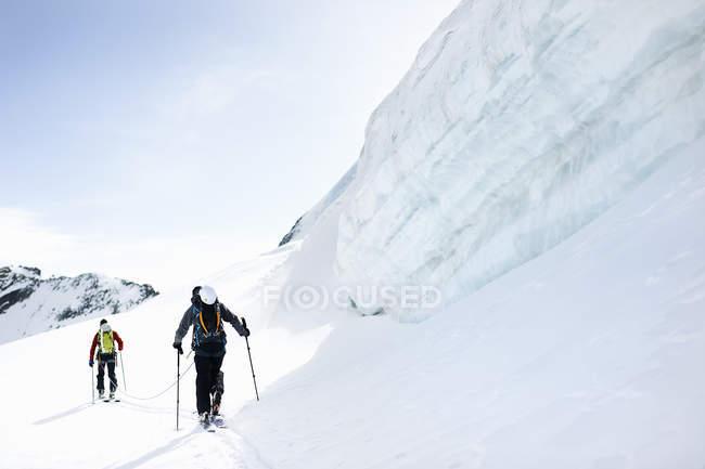 Rear view of mountaineers ski touring on snow-covered mountain, Saas Fee, Switzerland — Stock Photo