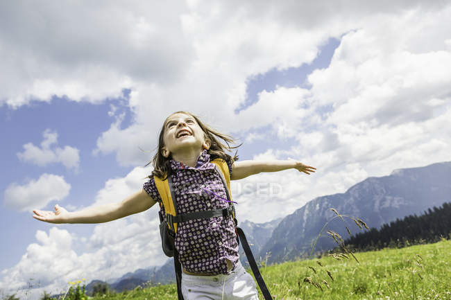 Young girl with arms out, Tyrol, Austria — Stock Photo