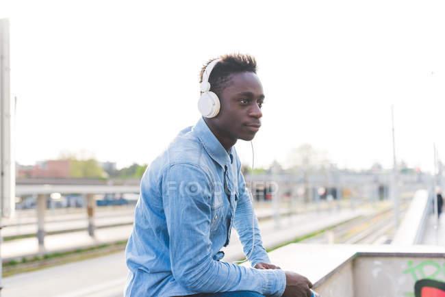 Portrait of man wearing headphones looking away, Milan, Italy — Stock Photo