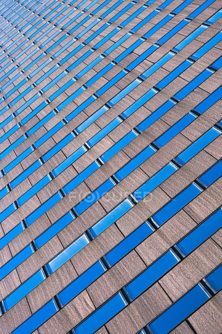 Abstract angled view of skyscraper facade — Stock Photo