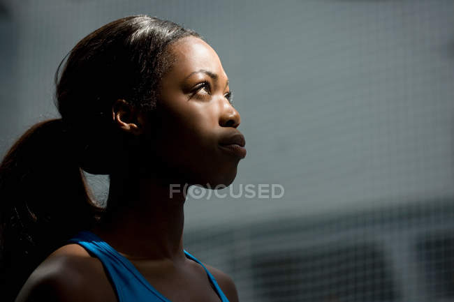 Woman looking up into light — Stock Photo