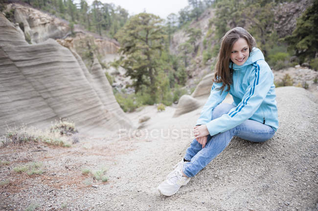 Mid adult woman sitting on rock, Teide National Park — Stock Photo