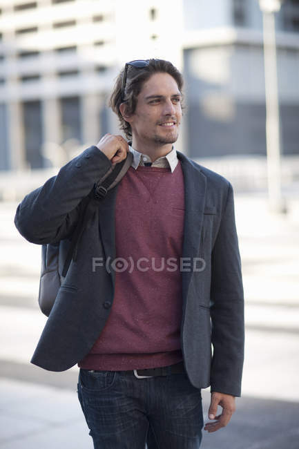 Mid adult man walking in city — Stock Photo