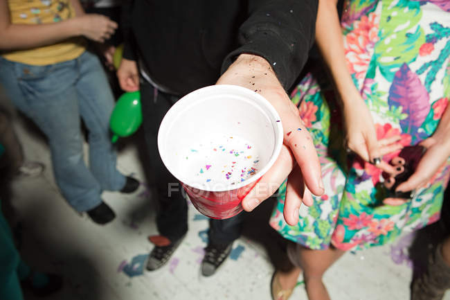 Young people with plastic cups at party — Stock Photo