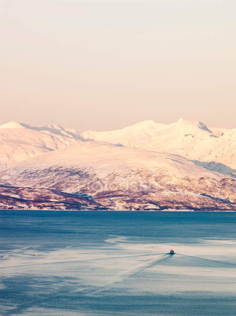 Ships sail down the Tromso Straits at sunset — Stock Photo